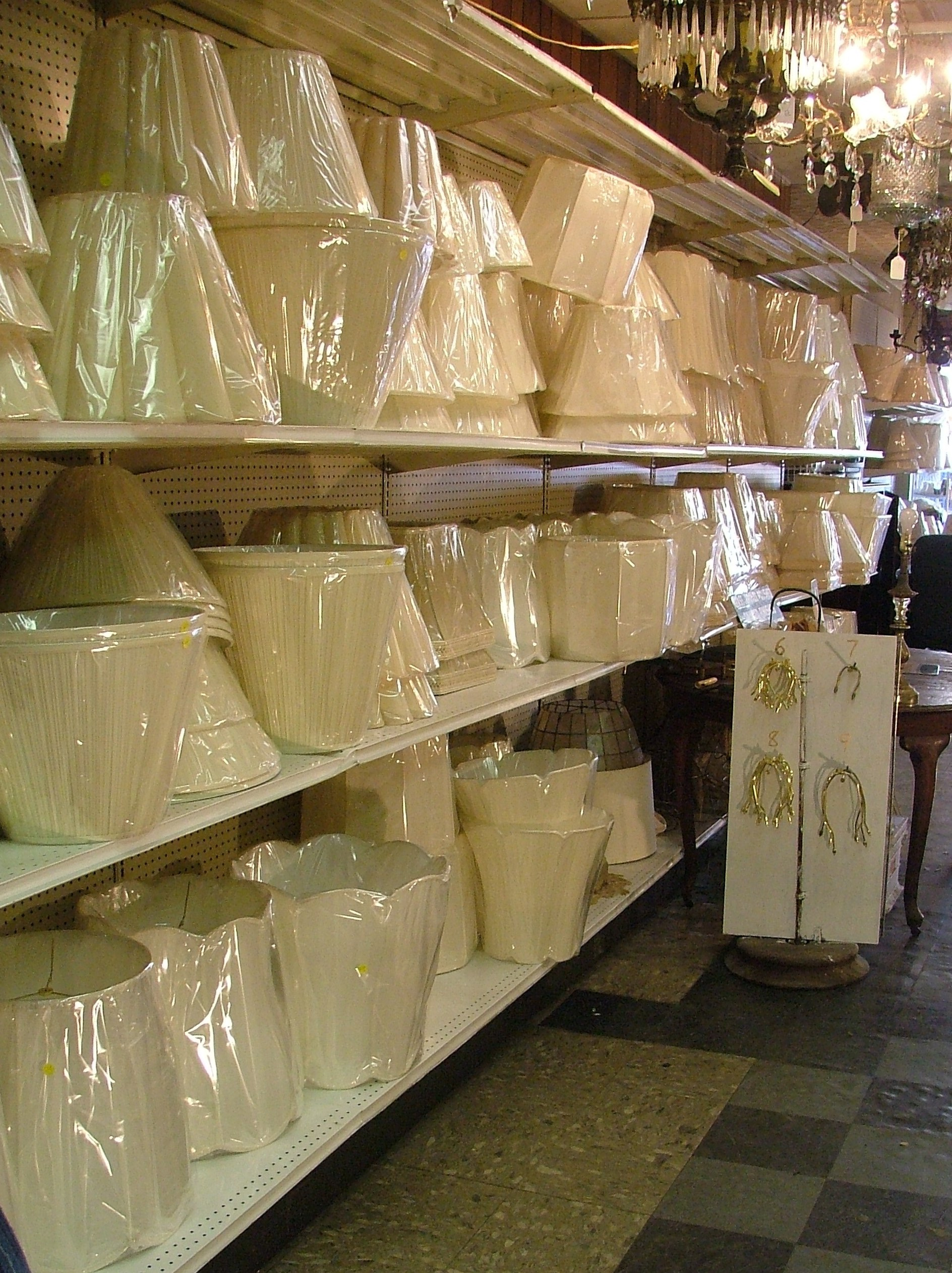 Hundreds of Lamp Shades in Stock.